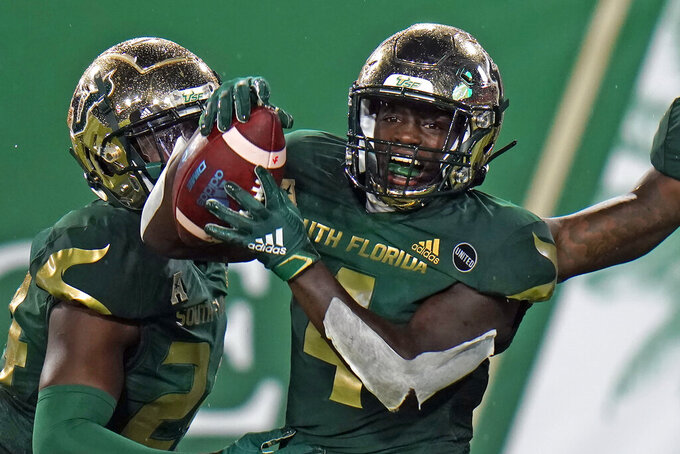 South Florida wide receiver Omarion Dollison (4) celebrates after blocking a punt and returning it for a touchdown against Citadel during the first half of an NCAA college football game Saturday, Sept. 12, 2020, in Tampa, Fla. (AP Photo/Chris O'Meara)