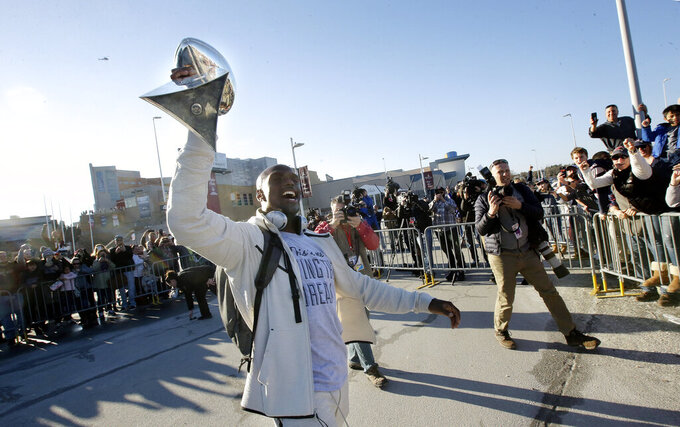 New England Patriots cornerback Jason McCourty holds the Super Bowl trophy for fans following the football teams arrival at Gillette Stadium, Monday, Feb. 4, 2019, in Foxborough, Mass., after defeating the Los Angeles Rams Sunday in NFL Super Bowl 53, in Atlanta, Ga. (AP Photo/Steven Senne)