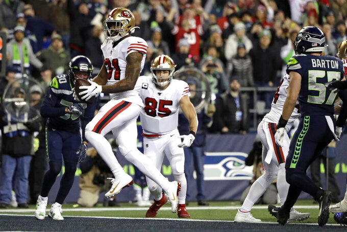 San Francisco 49ers' Raheem Mostert scores a touchdown against the Seattle Seahawks during the second half of an NFL football game, Sunday, Dec. 29, 2019, in Seattle. (AP Photo/Ted S. Warren)