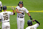 Pittsburgh Pirates' Cole Tucker, center, celebrates as he returns to the dugout after hitting a two-run home run off San Francisco Giants starting pitcher Derek Holland for his first hit in his first Major League Baseball game in Pittsburgh, Saturday, April 20, 2019. (AP Photo/Gene J. Puskar)