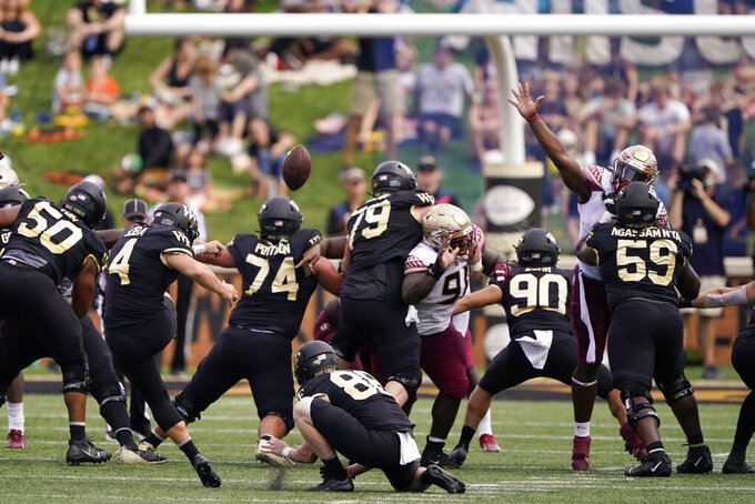 Wake Forest placekicker Nick Sciba (4) boots a field goal against Florida State during the first half of an NCAA college football game Saturday, Sept. 18, 2021, in Winston-Salem, N.C. (AP Photo/Chris Carlson)
