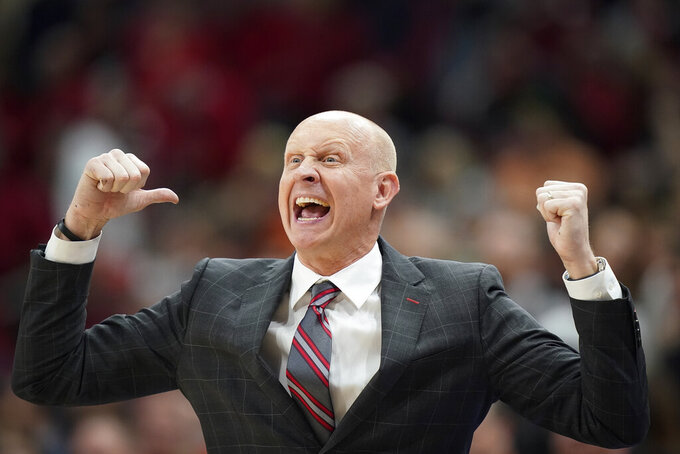 Louisville head coach Chris Mack shouts to players during the second half of an NCAA college basketball game against Virginia, Saturday, Feb 8, 2020 in Louisville, Ky. (AP Photo/Bryan Woolston)