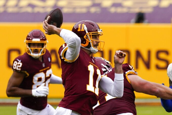 Washington Football Team quarterback Alex Smith throws during the first half of an NFL football game against the Los Angeles Rams Sunday, Oct. 11, 2020, in Landover, Md. (AP Photo/Steve Helber)