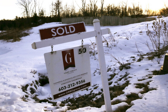In this Jan. 9, 2020, photo a sold sign is posted on a real estate sign in front of the foundation of a pre-constructed home in Derry, N.H. On Thursday, Jan 23, Freddie Mac reports on this week's average U.S. mortgage rates. (AP Photo/Charles Krupa)