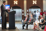 Trev Alberts speaks, as as his family, including wife Angie, right, and daughter Breanna, listen on after he was is introduced as Nebraska's new athletic director during a news conference, Wednesday, July 14, 2021, at Memorial Stadium in Lincoln, Neb. (Gwyneth Roberts/Lincoln Journal Star via AP)
