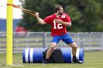 Indianapolis Colts quarterback Andrew Luck (12) warms up during practice at the NFL team's football training camp in Westfield, Ind., Friday, July 26, 2019. (AP Photo/Michael Conroy)