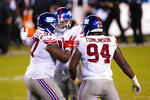New York Giants' Dexter Lawrence (97), Leonard Williams (99) and Dalvin Tomlinson (94) celebrate after stopping a two-point conversion attempt by the Philadelphia Eagles during the second half of an NFL football game, Thursday, Oct. 22, 2020, in Philadelphia. (AP Photo/Chris Szagola)