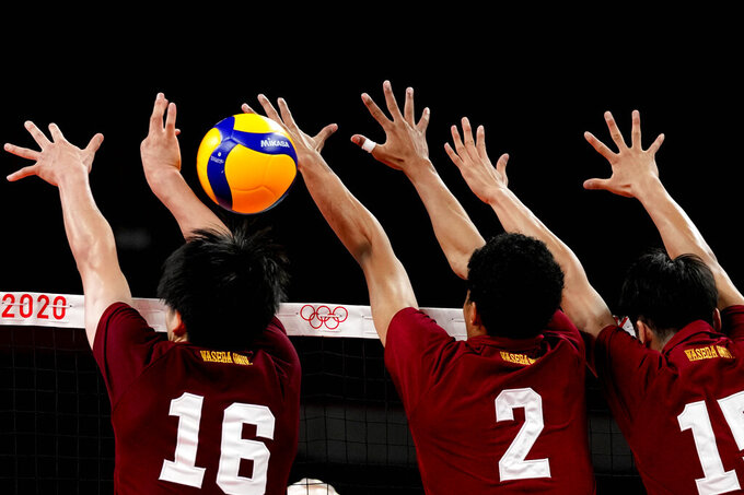 Volleyball players play during a rehearsal for the start of the volleyball preliminaries at Ariake Arena during the 2020 Summer Olympics, Friday, July 23, 2021, in Tokyo, Japan. (AP Photo/Frank Augstein)
