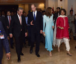 In this picture released by the Foreign Office, Pakistan's Foreign Minister Shah Mahmood Qureshi, left, escorts Britain's Prince William and his wife Kate as they arrive at the Nur Khan base in Islamabad, Pakistan, Monday, Oct. 14, 2019. They are on a five-day visit, which authorities say will help further improve relations between the two countries. (Pakistan Foreign Office via AP)