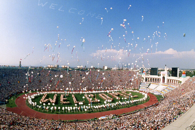 FILE - In this July 28, 1984, file photo, some 1,200 helium balloons are released into the air from the field of the Los Angeles Memorial Coliseum as part of the opening ceremony for the Summer Olympic Games in Los Angeles. (AP Photo/Dave Tenenbaum, FIle)