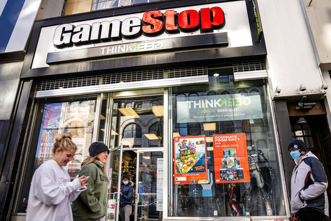 FILE - In this Jan. 28, 2021, file photo, pedestrians pass a GameStop store on 14th Street at Union Square, in the Manhattan borough of New York. Wall Street's mania over GameStop is on again, at least for one afternoon. Shares in the troubled video game company more than doubled Wednesday, Feb. 24, 2021 to $91.71 apiece, the stock's best day since Jan. 27, when it was going for $347.51 a share. (AP Photo/John Minchillo, File)
