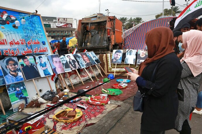 Posters of protesters who have been killed in demonstrations and their belongings are displayed in Tahrir Square during ongoing anti-government protests in Baghdad, Iraq, Tuesday, Dec. 3, 2019. At least 400 people have died since the leaderless uprising shook Iraq on Oct. 1, with thousands of Iraqis taking to the streets in Baghdad and the predominantly Shiite southern Iraq decrying corruption, poor services, lack of jobs and calling for an end to the political system that was imposed after the 2003 U.S. invasion. (AP Photo/Hadi Mizban)