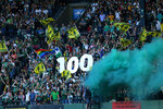 Members of the Timbers Army hold up a 100 sign celebrating midfielder Diego Valeri's 100th MLS goal, against Los Angeles FC during a soccer match Wednesday, July 21, 2021, in Portland, Ore. (Sean Meagher/The Oregonian via AP)