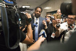 Attorney Norman Williams is surrounded by reporters after the arraignment of his client, James Currie, in Manhattan criminal court, Friday, Aug. 10, 2018, in New York. Currie is accused of throwing the lifeless body of his son, Mason Saldana, into the East River near the Brooklyn Bridge last Sunday. A tourist spotted the child's diaper-clad body and waded into the water to retrieve it. (AP Photo/Mary Altaffer)