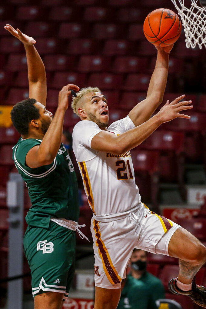 Minnesota forward Jarvis Omersa (21) drives to the basket after stealing the ball from Green Bay forward Terrance Thompson (21) during the first half of an NCAA college basketball game Wednesday, Nov. 25, 2020, in Minneapolis. (AP Photo/Bruce Kluckhohn)