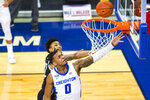 Creighton's Antwann Jones scores against Omaha's Marco Smith Jr. during the first half of an NCAA college basketball game in Omaha, Neb., Tuesday, Dec. 1, 2020. (AP Photo/Kayla Wolf)