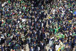 FILE  - In this Oct. 5, 2019, file photo, Notre Dame players greet fans as they enter the stadium before an NCAA college football game against Bowling Green, in South Bend, Ind. In a quirk this season, No. 5 Notre Dame enjoys a greater home-field advantage than most of its opponents: As of now, the Fighting Irish are slated to play in front of only one crowd bigger than their own, which is limited to about 10,000 people because of the pandemic. (AP Photo/Darron Cummings, File)