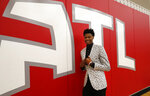 Atlanta Hawks first-round NBA draft pick Cam Reddish of Duke poses for a portrait after a news conference Monday, June 24, 2019, in Atlanta. (AP Photo/John Bazemore)