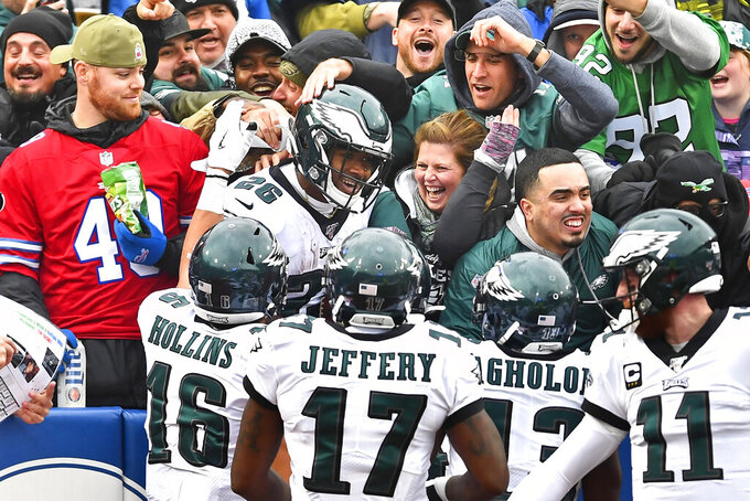 Philadelphia Eagles' Miles Sanders, center, celebrates his touchdown with fans during the second half of an NFL football game against the Buffalo Bills, Sunday, Oct. 27, 2019, in Orchard Park, N.Y. (AP Photo/Adrian Kraus)