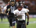 UNLV running back Lexington Thomas (3) runs the ball into the end zone during the second quarter of an NCAA college football game against Hawaii, Saturday, Nov. 17, 2018, in Honolulu. (AP Photo/Marco Garcia)