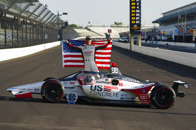 Marco Andretti poses during the front row photos session for the Indianapolis 500 auto race at Indianapolis Motor Speedway in Indianapolis, Monday, Aug. 17, 2020. Andretti won the pole for Sunday's race. (AP Photo/Michael Conroy)