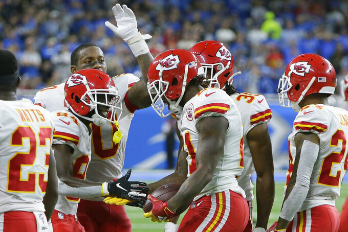 Kansas City Chiefs defensive back Bashaud Breeland, center, is greeted after scoring a touchdown after recovering a fumble at the Detroit Lions goal line and returning it 100-yards during the second half of an NFL football game, Sunday, Sept. 29, 2019, in Detroit. (AP Photo/Duane Burleson)