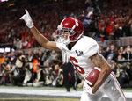 Alabama wide receiver DeVonta Smith (6) celebrates his touchdown during overtime of the NCAA college football playoff championship game against Georgia, Monday, Jan. 8, 2018, in Atlanta. Alabama won 26-23 in overtime. (AP Photo/David Goldman)