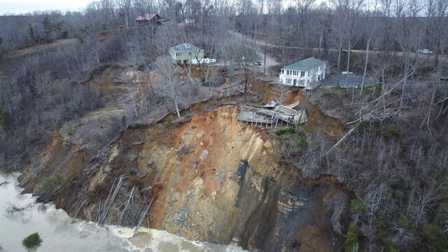 This drone photo provided by Hardin County Fire Department, Savannah, Tenn. on Feb. 15, 2030, shows the landslide on Chalk bluff on the Tennessee River.  Authorities say two homes were destroyed when a hillside collapsed near a swollen river in western Tennessee. News outlets report no one was injured in the slide, which occurred along the Tennessee River near the Hardin County community of Savannah.(Melvin Martin /Hardin County Fire Department, Savannah, Tenn. via AP)