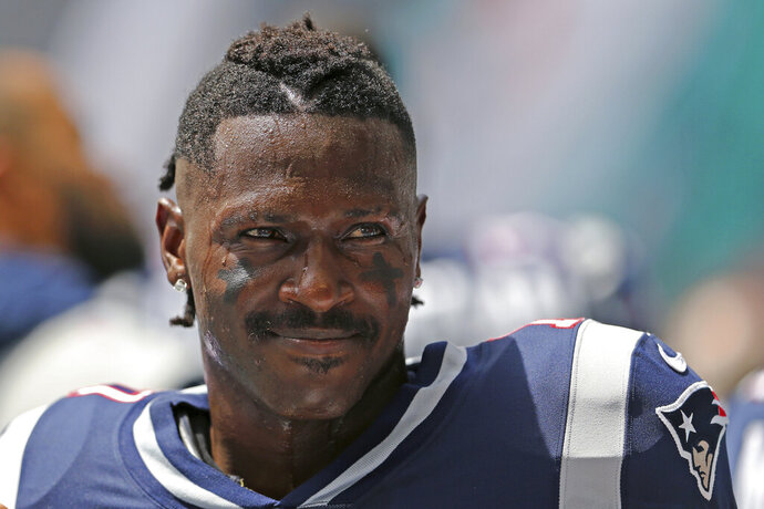 FILE - In this Sept. 15, 2019, file photo, then-New England Patriots wide receiver Antonio Brown looks on before the start of an NFL football game against the Miami Dolphins at Hard Rock Stadium in Miami Gardens, Fla. Antonio Brown has apologized to the Patriots and team owner Robert Kraft for any negative attention he brought to the team during his brief stint in New England. The four-time All-Pro receiver posted his apology on Instagram Tuesday, Nov. 19, 2019. (David Santiago/Miami Herald via AP, File)