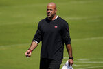FILE - In this Sept. 2, 2020, file photo, San Francisco 49ers defensive coordinator Robert Saleh watches during the NFL football team's practice in Santa Clara, Calif. Saleh, the New York Jets' new head coach, has families in neighborhoods all across the country celebrating the first known Muslim American to hold that position in NFL history. That's a source of great pride for a community that has been generally underrepresented in the league's on-field leadership roles. (AP Photo/Jeff Chiu, Pool, File)