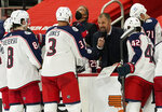 FILE - In this March 27, 2021, file photo, Columbus Blue Jackets assistant coach Brad Larsen talks to the team during the third period of an NHL hockey game against the Detroit Red Wings in Detroit. As the Blue Jackets tanked down the stretch last season, Larsen watched how players conducted themselves. Larsen, an assistant under John Tortorella, was in a good position to judge character as the losses piled up and the team dealt popular players at the trade deadline. He thinks that insight will work in his favor as he assembles a roster for the first time as an NHL head coach. (AP Photo/Carlos Osorio, File)
