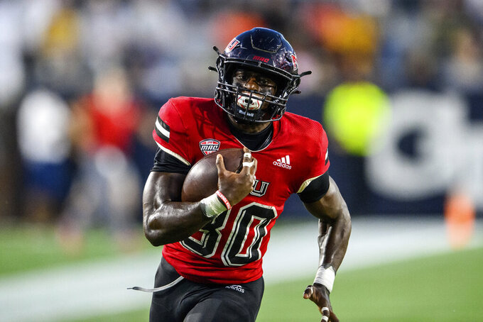Northern Illinois running back Harrison Waylee (30) runs toward the end zone for a touchdown during the first half of an NCAA college football game against Georgia Tech on Saturday, Sept. 4, 2021, in Atlanta. (AP Photo/Danny Karnik)