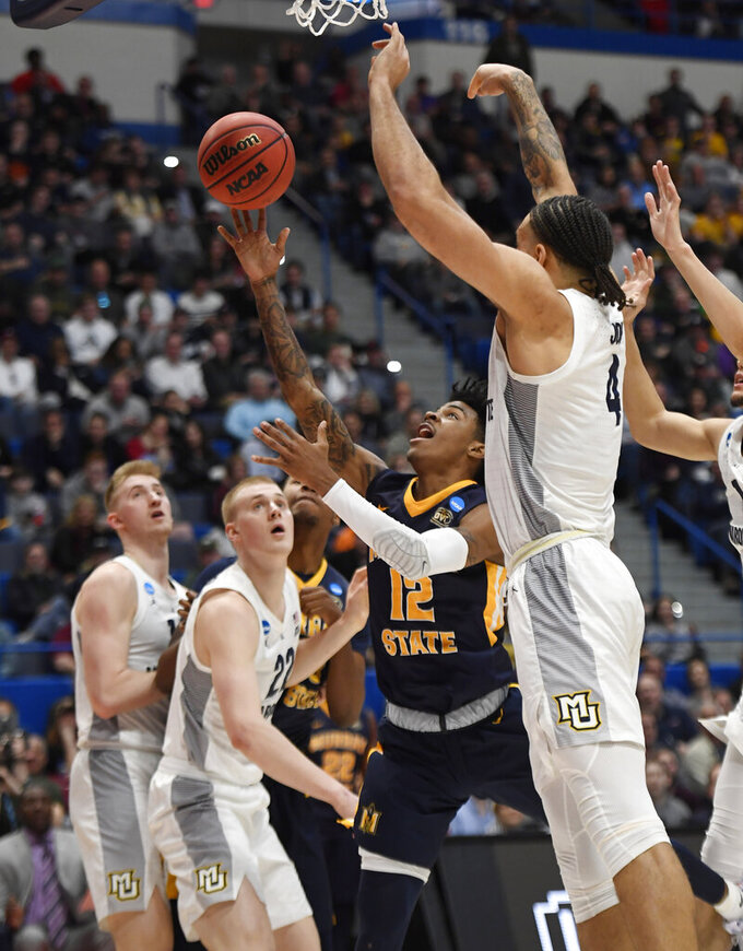 Murray State's Ja Morant (12) shoots as Marquette's Theo John (4) defends during the second half of a first-round game in the NCAA men's college basketball tournament Thursday, March 21, 2019, in Hartford, Conn. (AP Photo/Jessica Hill)