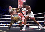 Defending champion Andy Ruiz Jr., left, during his fight against Britain's Anthony Joshua in their World Heavyweight Championship contest at the Diriyah Arena, Riyadh, Saudi Arabia. (Nick Potts/PA via AP)