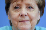 German Chancellor Angela Merkel, smiles as she holds her annual summer news conference in Berlin, Germany, Thursday, July 22, 2021. (Hannibal Hanschke/Pool Photo via AP)