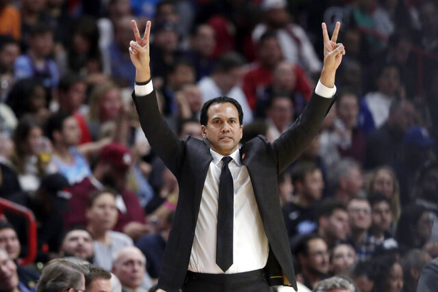 Miami Heat head coach Erik Spoelstra watches during the first half of an NBA basketball game against the Philadelphia 76ers, Monday, Feb. 3, 2020, in Miami. The Heat won 137-106. (AP Photo/Lynne Sladky)