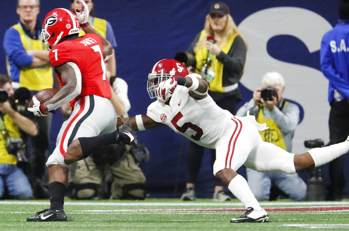 Georgia running back D'Andre Swift (7) runs against Alabama defensive back Shyheim Carter (5) during the first half of the Southeastern Conference championship NCAA college football game, Saturday, Dec. 1, 2018, in Atlanta. (AP Photo/John Bazemore)