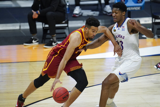 USC forward Isaiah Mobley (3) drives on Kansas forward David McCormack (33) during the second half of a men's college basketball game in the second round of the NCAA tournament at Hinkle Fieldhouse in Indianapolis, Monday, March 22, 2021. (AP Photo/Paul Sancya)