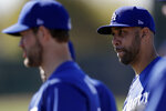 Los Angeles Dodgers pitcher David Price, right, stands with pitcher Clayton Kershaw, left, during spring training baseball Friday, Feb. 14, 2020, in Phoenix. (AP Photo/Gregory Bull)