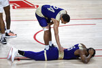 Alcorn State forward Malik Hardmon, bottom, reacts after being called for a foul as Arne Morris offers encouragement during the first half of an NCAA college basketball game against Houston, Sunday, Dec. 20, 2020, in Houston. (AP Photo/Eric Christian Smith)