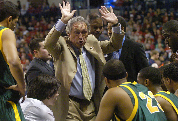FILE - In this Monday, Jan. 21, 2008, file photo, San Francisco basketball coach Eddie Sutton talks with his team in the first half of an NCAA college basketball game against Gonzaga, in Spokane, Wash. Sutton, the Hall of Fame basketball coach who led three teams to the Final Four and was the first coach to take four schools to the NCAA Tournament, died Saturday, May 23, 2020. He was 84. (AP Photo/Ingrid Barrentine, File)