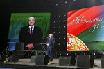 Belarusian President Alexander Lukashenko addresses a women's forum in Minsk, Belarus, Thursday, Sept. 17, 2020. Lukashenko has given a speech at a women's forum with some good quotes—he's announced Belarus will close the border with Ukraine, Poland and Lithuania, and is mobilizing half the army. (BelTA Pool Photo via AP)