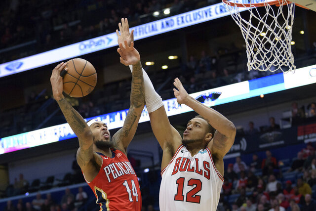 New Orleans Pelicans forward Brandon Ingram (14) appears to be fouled by Chicago Bulls forward Daniel Gafford (12) but there was no call in the second half of an NBA basketball game in New Orleans, Wednesday, Jan. 8, 2020. (AP Photo/Matthew Hinton)