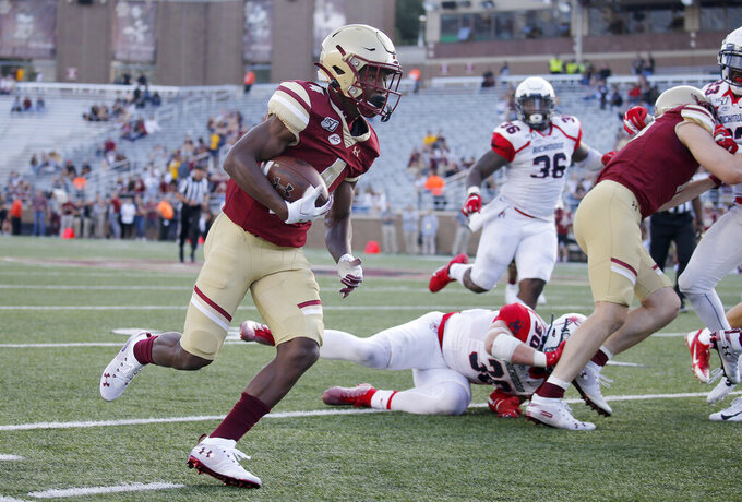 Boston College wide receiver Zay Flowers (4) rushes with the ball past Richmond defenders during the second half of an NCAA college football game, Saturday, Sept. 7, 2019, in Boston. (AP Photo/Mary Schwalm)