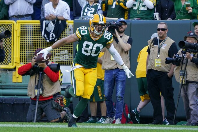 Green Bay Packers' Jimmy Graham celebrates his touchdown catch during the second half of an NFL football game against the Oakland Raiders Sunday, Oct. 20, 2019, in Green Bay, Wis. (AP Photo/Morry Gash)