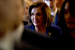 House Speaker Nancy Pelosi of Calif., walks to her office after signing the Coronavirus Aid, Relief, and Economic Security (CARES) Act after it passed in the House on Capitol Hill, Friday, March 27, 2020, in Washington. The $2.2 trillion package will head to head to President Donald Trump for his signature. (AP Photo/Andrew Harnik)