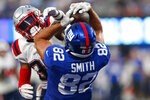 New York Giants tight end Kaden Smith (82) catches a pass for a touchdown in front of New England Patriots free safety Adrian Colbert (30) during the first half of an NFL preseason football game Sunday, Aug. 29, 2021, in East Rutherford, N.J. (AP Photo/Noah K. Murray)