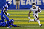 Mississippi State running back Kylin Hill (8) carries during the second half of the team's NCAA college football game against Kentucky, Saturday, Oct. 10, 2020, in Lexington, Ky. (AP Photo/Bryan Woolston)