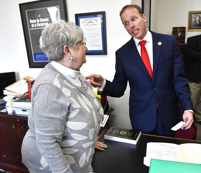 State Rep. Robert Goforth, R-East Bernstadt, right, talks with Mary Sue Helm, Executive Director of the Kentucky Office of Elections, as he files to be a candidate for Governor at the Kentucky State Capitol in Frankfort, Ky., Tuesday, Jan. 8, 2019. (AP Photo/Timothy D. Easley)
