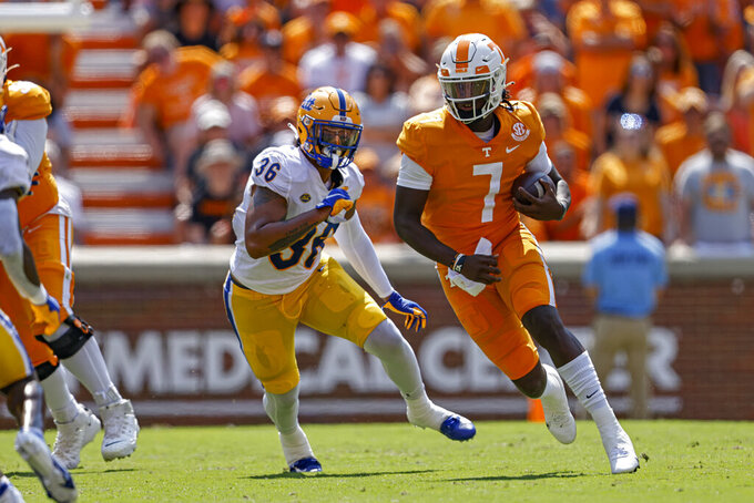 Tennessee quarterback Joe Milton III (7) runs for yardage as he's chased by Pittsburgh linebacker Chase Pine (36) during the first half of an NCAA college football game Saturday, Sept. 11, 2021, in Knoxville, Tenn. (AP Photo/Wade Payne)